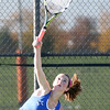 St. Charles North's Shelby Thomas serves while playing for third place in No. 1 singles during the UEC tournament at St. Charles East on Oct. 8.