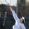 St. Charles East's Olivia Gapuz serves while playing for fifth place in No. 1 singles during the UEC tournament at St. Charles East on Oct. 8.