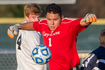Cary Grove's Sergio Lemus (1) makes a save in fornt of Jacobs' Patrick Murphy Tuesday, Oct. 18th, 2016 in the Class 3A Regional boys Soccer playoffs held at Crystal Lake South High School in Crystal Lake.Jacobs advances beating Cary Grove by the score of 2-0. KKoontz-for Shaw Media