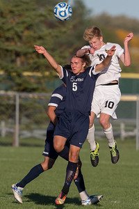 Jacobs' Ryan Blanchard (10) flies over Cary Grove's Isaiah Glaysher (5) Tuesday, Oct. 18th, 2016 in the Class 3A Regional boys Soccer playoffs held at Crystal Lake South High School in Crystal Lake.Jacobs advances beating Cary Grove by the score of 2-0. KKoontz-for Shaw Media