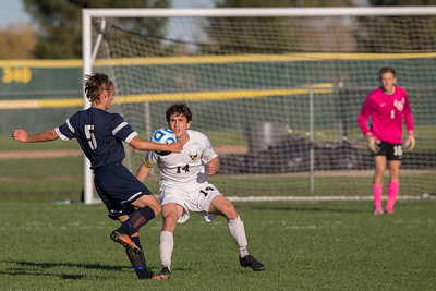 Cary Grove's Isaiah Glaysher (5) takes a shot on goal in fornt of Jacobs' defender Jacob Sabella (14) Tuesday, Oct. 18th, 2016 in the Class 3A Regional boys Soccer playoffs held at Crystal Lake South High School in Crystal Lake.Jacobs advances beating Cary Grove by the score of 2-0. KKoontz-for Shaw Media