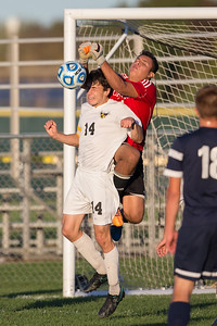 Cary Grove's goal tender Sergio Lemus (1) punches the ball just before Jacobs' Jacob Sabella (14) could get his head on it Tuesday, Oct. 18th, 2016 in the Class 3A Regional boys Soccer playoffs held at Crystal Lake South High School in Crystal Lake.Jacobs advances beating Cary Grove by the score of 2-0. KKoontz-for Shaw Media