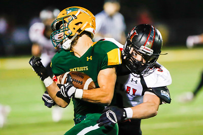 Sarah Nader - snader@shawmedia.com Stevenson's Anthony Sibo (left) is tackled by Huntley's Tyler Szekely during the second quarter of Friday's Class 8A playoff football game in Lincolnshire Oct. 28, 2016. Huntley won, 21-20.