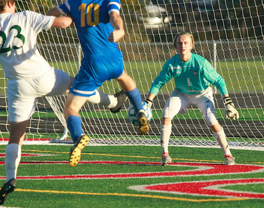 Candace H. Johnson- For Shaw Media Grayslake Central goalie, David Young, defends as his teammate Jack Spalding, tries to stop a shot on goal by Johnsburg's Dean Wiersum in the first half during the regional semi-final game at Antioch Community High School.