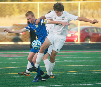 Candace H. Johnson- For Shaw Media Johnsburg's Todd Dombrowski battles for control with Grayslake Central's Matt Kosikowski and Jack Spalding in the second half during the regional semi-final game at Antioch Community High School.