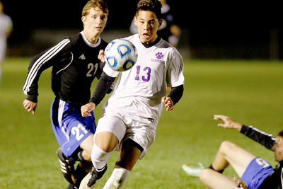 Sarah Nader - snader@shawmedia.com Burlington Central's Alexander Bialek and  and Hampshire's Jesus Rivera go after the ball during the second half of Wednesday's Class 2A Burlington Central regional semifinal Oct. 19, 2016. Hampshire won in overtime, 3-2.