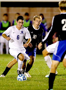 Sarah Nader - snader@shawmedia.com Hampshire's Tyler Fairwood dribbles the ball during the second half of Wednesday's Class 2A Burlington Central regional semifinal against Burlington Central Oct. 19, 2016. Hampshire won in overtime, 3-2.
