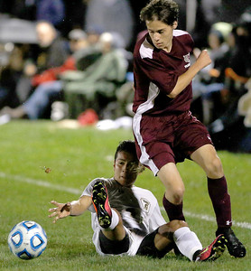 Sarah Nader - snader@shawmedia.com Sycamore's jacob Parra slides into Prairie Ridge's Ryan Barbour during the first half of Wednesday's Class 2A Burlington Central regional  semifinal Oct. 19, 2016. Prairie Ridge won, 4-0.