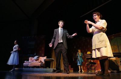 "Sophie, right, senior Tori Roberts, finds the door key as she talks with Tyler Thorncraft, sophomore Viktor Wilson-Miller, during their rehearsal for the play ""Honeymoon at Graveside Manor"" at Marian Central Catholic on Tuesday, October 18, 2016 in Woodstock, Ill. John Konstantaras photo for the Northwest Herald"