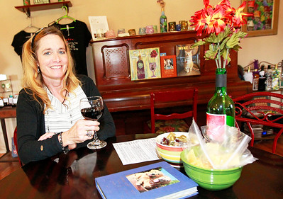Candace H. Johnson-For Shaw Media Deb Trombino, owner, drinks a glass of her award-winning Sweet Frontenac wine in the tasting room and gift shop at the Vigneto del Bino Vineyard & Winery in Antioch.