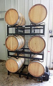 Candace H. Johnson-For Shaw Media American oak wine barrels are lined up to age Marquette and Frontinac wines at the Vigneto del Bino Vineyard & Winery in Antioch.