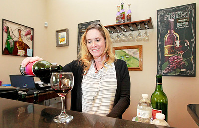 Candace H. Johnson-For Shaw Media Deb Trombino, owner, pours a glass of her award-winning Sweet Frontenac wine at the Vigneto del Bino Vineyard & Winery in Antioch.