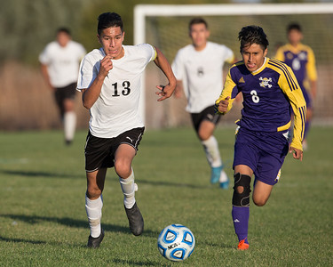 Harvard forward Alonzo Carrillo (13) and Belvidere forward Rogelio Flores run down a free ball at the class 2A soccer regional final Saturday, Oct. 22nd, 2016 at Woodstock North High School in Woodstock. Belvidere wins 1-0. KKoontz- For Shaw Media