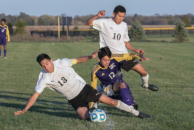 Belvidere defender Fernando Gomez (12) splits the offensive attack from Harvard's Alonzo Carillo (13) and Ismael Albarran (10) during the class 2A soccer regional final Saturday, Oct. 22nd, 2016 at Woodstock North High School in Woodstock. Belvidere wins 1-0. KKoontz- For Shaw Media