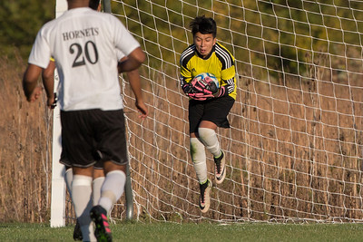 Harvard goalie Hugo Escobar (0) makes a save on a Belvidere shot at the class 2A soccer regional final Saturday, Oct. 22nd, 2016 at Woodstock North High School in Woodstock. Belvidere wins 1-0. KKoontz- For Shaw Media