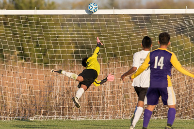 Harvard goalie Hugo Escobar (0) deflects a Belvidere shot over the bar at the class 2A soccer regional final Saturday, Oct. 22nd, 2016 at Woodstock North High School in Woodstock. Belvidere wins 1-0. KKoontz- For Shaw Media