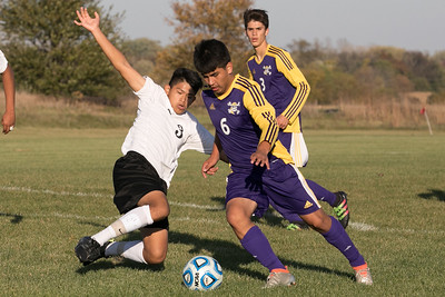 Harvard defender Jesse Oros (3) slides in front of Belvidere forward Jorge Resendiz (6) at the class 2A soccer regional final Saturday, Oct. 22nd, 2016 at Woodstock North High School in Woodstock. Belvidere wins 1-0. KKoontz- For Shaw Media
