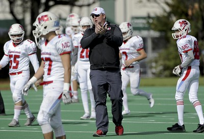 Matt Marton - For Shaw Media  Marian Central head coach Michael Maloney works with the team before their game against St. Patrick at Hanson Stadium on Saturday, Oct. 22, 2016, in Chicago, Ill.