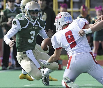 Matt Marton - For Shaw Media Marian Central linebacker Steve Pinter (9)  tries to get a fumble as St. Patrick's quarterback  Anthony Mazzenga (3) looks on  in the first half of their game at Hanson Stadium on Saturday, Oct. 22, 2016, in Chicago, Ill.