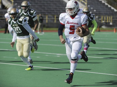 Matt Marton - For Shaw Media Marian Central quarterback Gavin Scott (5)  runs from St. Patrick players to score a touchdown in the first half of their game at Hanson Stadium on Saturday, Oct. 22, 2016, in Chicago, Ill.