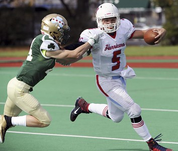 Matt Marton - For Shaw Media Marian Central quarterback Gavin Scott (5)  runs from St. Patrick's Joey Lombardi (24) in the first half of their gameat Hanson Stadium on Saturday, Oct. 22, 2016, in Chicago, Ill.