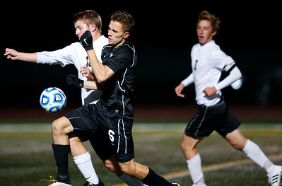 Noah Melick (6) from Jacobs and Alex Lee (13) from McHenry battle for a ball during the first half of their Class 3A Huntley Boys Soccer Sectional semi-final on Tuesday October 25, 2016 in Huntley. The Golden Eagles defeated the Warriors 2-1.  John Konstantaras photo for the Northwest Herald