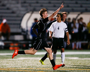 Daniel Buirge (7) from Jacobs celebrates his goal during the first quarter of their Class 3A Huntley Boys Soccer Sectional semi-final against McHenry on Tuesday, October 25, 2016 in Huntley. The Golden Eagles defeated the Warriors 2-1.  John Konstantaras photo for the Northwest Herald