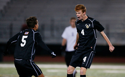 Patrick Murphy (4) from Jacobs celebrates with Colin Walsh (5) after beating McHenry in their Class 3A Huntley Boys Soccer Sectional semi-final on Tuesday October 25, 2016 in Huntley. The Golden Eagles defeated the Warriors 2-1. Murphy scored the winning goal in the final minutes of the second quarter.  John Konstantaras photo for the Northwest Herald
