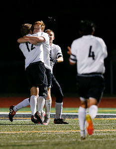 Zac Gorniak (21) from McHenry hugs James Mulhall (12) after his goal during the second quarter of their Class 3A Huntley Boys Soccer Sectional semi-final against Jacobs on Tuesday October 25, 2016 in Huntley. The Golden Eagles defeated the Warriors 2-1.  John Konstantaras photo for the Northwest Herald