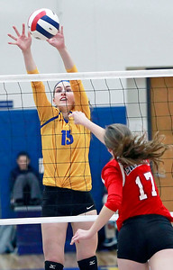Candace H. Johnson-For Shaw Media Warren's Marissa Kuula tries to block an attack by Grant's Ashley Freund in the third game at Warren Township High School in Gurnee.