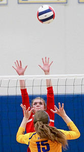 Candace H. Johnson-For Shaw Media Grant's Emily Bringer looks to block a ball sent over by Warren's Marissa Kuula in the first game at Warren Township High School in Gurnee.