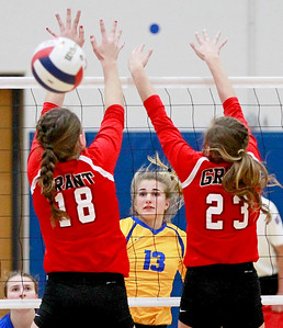 Candace H. Johnson-For Shaw Media Warren's Natalie McNally watches her spike get past Grant's Mallory Harrity and Kayla Dabrowski in the third game at Warren Township High School in Gurnee.