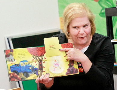 "Candace H. Johnson-For Shaw Media Sandy Doetsch, children's clerk, reads the book, ""Little Blue Truck's Halloween"" during the Tiny Tots Halloween program at the Antioch Public Library District."