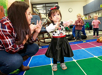 "Candace H. Johnson-For Shaw Media Galia Castillo, of Antioch watches her daughter, Victoria, 2, listen to the song, ""Itsy Bitsy Spider,"" during the Tiny Tots Halloween program at the Antioch Public Library District."