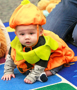 Candace H. Johnson-For Shaw Media Ethan Sparrowgrove, six-months-old, of Spring Grove, watches the kids play in the Tiny Tots Halloween program at the Antioch Public Library District. Ethan was at the library with his sister, Audrey, 2, and mother, Sarah.