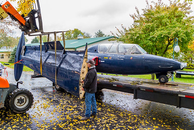 Crews at the Volo Auto Museum in Volo, IL. unload a French military jet, the Fouga CM-170 Magister for display, Wednesday, Oct. 26th, 2016. KKoontz – for Shaw Media