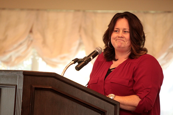 Bekka Dove of Young Living Essential Oils gives the keynote address during the Fifth Annual Women of Distinction luncheon at the St. Charles Country Club. The event was sponsored by Shaw Media, owner of the Kane County Chronicle and Kane County Magazine, along with Caldwell Consulting Group, State Street Jewelers, Blue Goose Market, Elements Massage, Town and Country Gardens and Vanishing Ink.