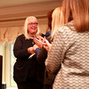 Lynn Caldwell is presented with a Women of Distinction award during the Fifth Annual Women of Distinction luncheon at the St. Charles Country Club. The event was sponsored by Shaw Media, owner of the Kane County Chronicle and Kane County Magazine, along with Caldwell Consulting Group, State Street Jewelers, Blue Goose Market, Elements Massage, Town and Country Gardens and Vanishing Ink.