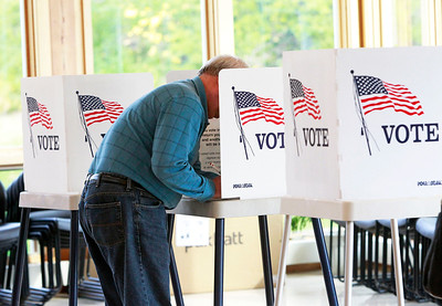 Candace H. Johnson-For Shaw Media Jon Dudley, of Lindenhurst votes during Early Voting at the Antioch Township Hall in Lake Villa.