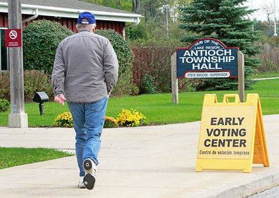 Candace H. Johnson-For Shaw Media A man walks into the Early Voting Center to vote at the Antioch Township Hall in Lake Villa.