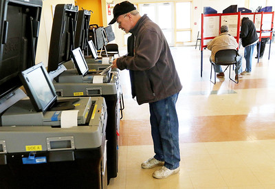 Candace H. Johnson-For Shaw Media David Chesonis, of Antioch casts his ballot during Early Voting at the Antioch Township Hall in Lake Villa.