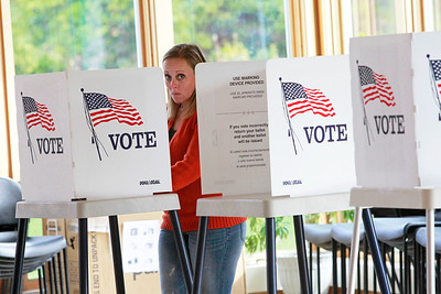 Candace H. Johnson-For Shaw Media Christie Andell, of Lake Villa votes during Early Voting at the Antioch Township Hall in Lake Villa.