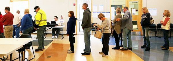 Candace H. Johnson-For Shaw Media People wait on line to vote during Early Voting at the Antioch Township Hall in Lake Villa.