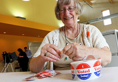"Candace H. Johnson-For Shaw Media Election Judge Kathryn Hausman, of Antioch gets the ""I Voted Today!"" stickers ready to give out during Early Voting at the Antioch Township Hall in Lake Villa."