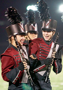 Candace H. Johnson-For Shaw Media Antioch's Adalia Tate and Grace Lockefeer dance to the music holding their clarinets for the marching band at half-time during the varsity football game against Wauconda at Antioch Community High School.