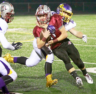 Candace H. Johnson-For Shaw Media Antioch's Hunter Price gets tackled by Wauconda's Kenyon Rejczyk in the third quarter at Antioch Community High School.