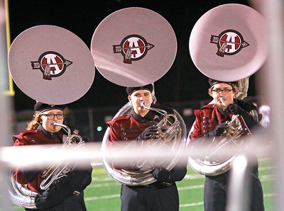 Candace H. Johnson-For Shaw Media Antioch's Kar Toman, Devin Zuidema and Dane Kish play their tubas with the marching band at half-time during the varsity football game against Wauconda at Antioch Community High School.