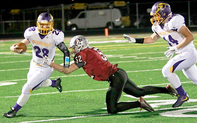 Candace H. Johnson-For Shaw Media Wauconda's Jacob Bicknase gets tackled by Antioch's Logan Weber in the third quarter at Antioch Community High School.