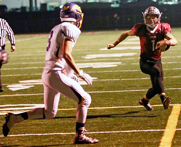 Candace H. Johnson-For Shaw Media Antioch's Branden Gallimore (on right) runs towards the end zone against Wauconda's William Kerbs in the third quarter at Antioch Community High School.