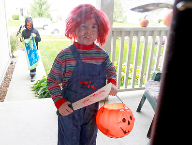Candace H. Johnson-For Shaw Media Travis York, 11, of Round Lake and his brother, Kolt, 7, come to the door waiting for candy during trick-or-treating in the Valley Lakes subdivision in Round Lake.
